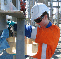 Photo of a graduate work on site